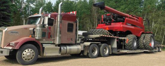 truck-hauling-combine