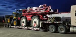 Pal-HC-Sparyer-And-Tractor-shipping-equipment-canada-us-cross-border-drivers-action