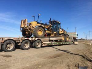 heavy-equipment-load-cross-border-us-canada-machinery