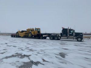 Scraper-Load-trusted-dispatch-canada-shipping-heavy-equipment-company